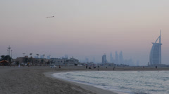 Dusk Dawn Twilight Light Burj Al Arab Dubai Skyline People Relaxing Tourists UAE Stock Footage