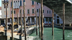 Gondola travelling under Venice bridge Stock Footage