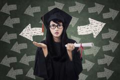confused female student in graduation gown - stock illustration