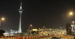 4K video of the Macau Tower and busy freeway at night Stock Footage