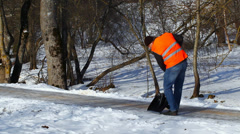 Man with a snow shovel on the sidewalk in winter episode 3 Stock Footage