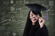 Stock Photo of female student in an academic gown