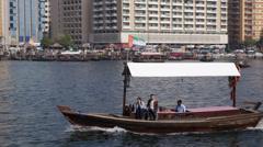 Tourists Enjoy Taxi Boat Tour Trip Ride Abra Old Deira Creek Dubai City Daylight Stock Footage