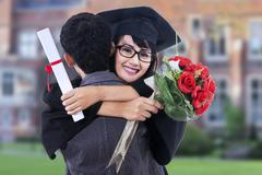 happy student in graduation gown - stock photo