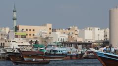 Freight Ship Cargo Dhow Arabian Transportation Docks UAE Bin Naim Old Mosque Day Stock Footage