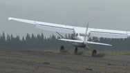 Stock Video Footage of AIRPLANE LANDS ON ALASKAN BEACH