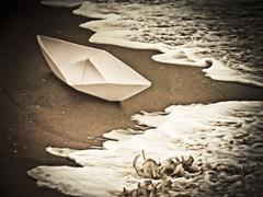 Paper boat, stop global warming message, concept Stock Photos