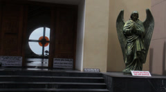 Pan across angel statues at Church Stock Footage