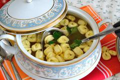 Tortellini in meat broth Stock Photos