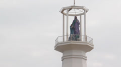 Sri Lanka tilt up from beack flower to top of lighthouse Stock Footage