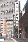 Closeup narrow lane and buildings in city Stock Photos