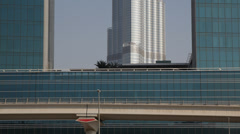 Elevated Metro Train Departing Arriving Passing Dubai Skyline Burj Khalifa Tower Stock Footage