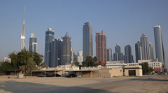 Children Playing Poor Houses Area Neighborhood Burj Khalifa Dubai Skyline Towers Stock Footage