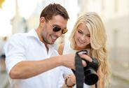 Stock Photo of smiling couple with photo camera