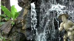 Thailand Bangkok 046  garden of wat pho temple, a figure and a fountain Stock Footage