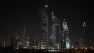 Stock Video Footage of Dubai Skyline Urban Scene United Arab Emirates UAE Middle East Night Evening