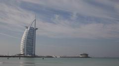 Happy People Travelers Swim Dubai Jumeirah Beach Burj Al Arab Famous Sea Resort - stock footage