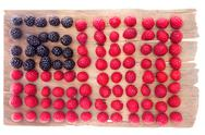 Stock Photo of artistic display of usa flag with raspberries and blackberries