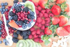 Healthy nutritious fresh fruits on a wooden table Stock Photos