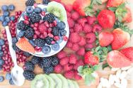 Stock Photo of healthy nutritious fresh fruits on a wooden table