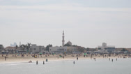 Stock Video Footage of Maharba Mosque Dubai Skyline Jumeirah Beach People Swim Sunbathing Sun Tanning