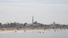 Maharba Mosque Dubai Skyline Jumeirah Beach People Swimming Water Sport Exotic - stock footage