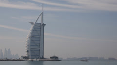 Cruise Ship Yacht Sail Boat Passing Burj Al Arab Landmark Dubai Skyline Seascape Stock Footage