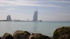 Burj Al Arab Coast Rocks Low Waves Beautiful Blue Water White Dubai Seascape Day Stock Footage