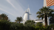 Stock Video Footage of Burj Al Arab Luxury 5 Star Hotel Artificial Island Exotic Palm Tree Vacation UAE
