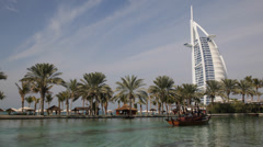 Burj Al Arab Madinat Jumeirah Water Dubai People Tourist Enjoy Boat Tour Passing Stock Footage