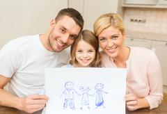 happy family drawing at home - stock photo