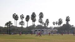 Dubai Safa Park Holiday People Enjoy Sport Playing Football Kid Children Running Stock Footage