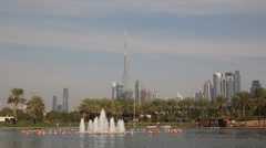 Safa Park Dubai Skyline Skyscrapers Burj Khalifa People Enjoy Boat Ride Lake UAE Stock Footage