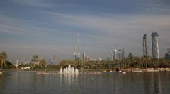 Safa Park Dubai Skyline Burj Khalifa People Enjoy Holiday Boat Ride Exotic Pond Stock Footage