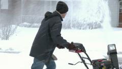 4K Man Uses Snowblower 3984 Stock Footage