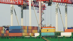 Unloading containers from cargo ship - stock footage