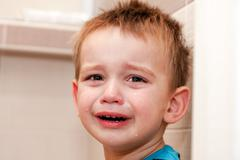 Portrait Of Crying Baby Boy In Home. Stock Photos