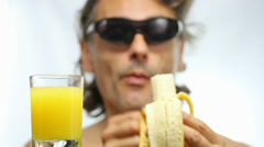 Eating banana over white background Stock Footage