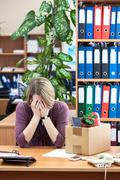 layoff at work, employee upset with things to take away - stock photo