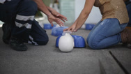 Stock Video Footage of Paramedic teach student CPR