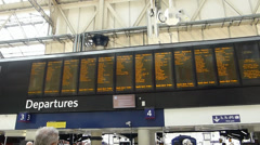 Train schedule at departure hall of Waterloo station, London, UK, England Stock Footage
