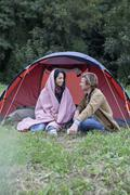Young couple sitting near dome tent Stock Photos
