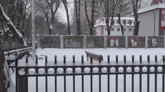 Deserted Amusement Park In A Snow Storm Pan-Shot Stock Footage