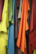 Close-up of various colors of leather textiles - stock photo