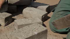 Construction worker cleaning bricks Stock Footage