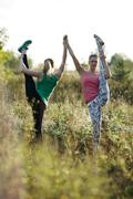 Two supple athletic women working out together - stock photo