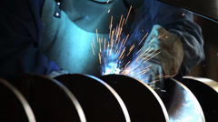 Welder welding a steel spiral Stock Footage