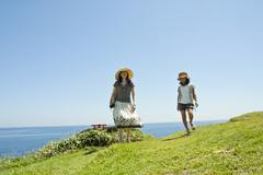 Mother walking with daughter at coastline Stock Photos