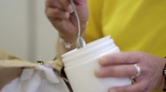Worker bottles some biological ingredients - stock footage