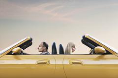 Man and woman driving car Stock Photos